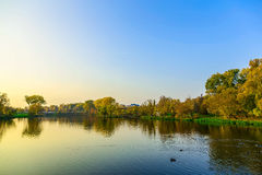 Autumn Landscape with Trees and Lake in the City Park at Sunset Royalty Free Stock Photos