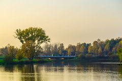 Autumn Landscape with Trees and Lake in the Urban Park at Sunset Stock Photography