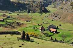 Autumn landscape with a village in the mountains Stock Photography