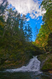 Autumn landscape with a waterfall on the creek taiga. Royalty Free Stock Photo