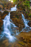 Autumn landscape with a waterfall-2. Stock Photos