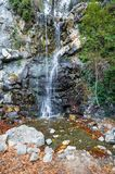 Autumn landscape with a waterfall stock photography
