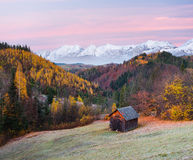 Autumn Landscape with a wooden house in the mountains Royalty Free Stock Photography