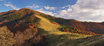 Autumn landscape with wooden houses in the mountains Stock Image