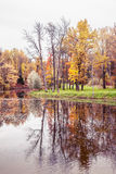 Autumn landscape with yellow and orange trees and reflection in Royalty Free Stock Image