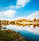 Autumn Landscape. Yellow Trees, Blue Sky and Lake. Royalty Free Stock Photo