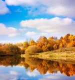 Autumn Landscape. Yellow Trees, Blue Sky and Lake. Royalty Free Stock Image