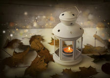 Autumn lantern with candle, lights, sparkle and dried leaves Stock Photography