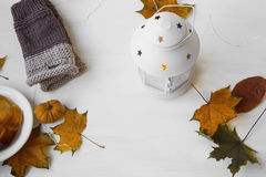 Autumn lantern with leaves and hand-warmers Royalty Free Stock Images