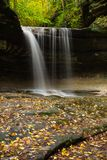 Autumn in LaSalle Canyon. Water cascading down LaSalle Canyon on a Autumn/ Fall morning.  Starved Rock State Park, Illinois, USA Royalty Free Stock Image