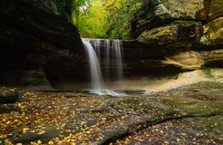 Autumn in LaSalle Canyon. Water cascading down LaSalle Canyon on a Autumn/ Fall morning.  Starved Rock State Park, Illinois, USA Royalty Free Stock Images