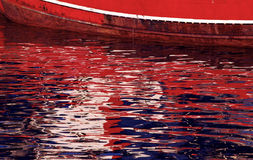 Autumn late and warm light reflexions on water background. Reflexions on the calm water of the harbour ,iluminated by autumn late and warm light Royalty Free Stock Photography