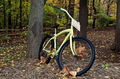 Autumn leaf in bicycle wheel Royalty Free Stock Image