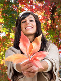 Autumn leaf and brunette woman Stock Image