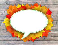Autumn leaf cloud with wooden background Royalty Free Stock Photos