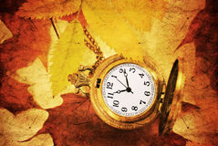 Autumn leaf and vintage pocket watch Royalty Free Stock Photo