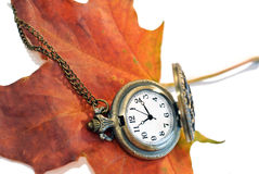 Autumn leaf and vintage pocket watch on white Stock Photography
