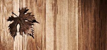 Autumn leaf wooden border. Autumn leaf  border over natural wood background, old dry leaf shape, nature at fall Royalty Free Stock Image