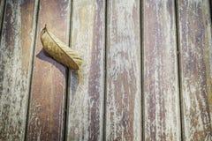 Autumn leaf on wooden floor. Autumn leaf on wooden floor, outdoor Stock Image