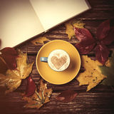 Autumn leafs, book and coffee cup Stock Image