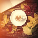 Autumn leafs, book and coffee cup . Royalty Free Stock Photography