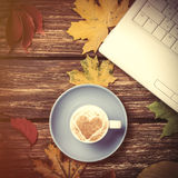 Autumn leafs, notebook and coffee cup on table. Stock Images