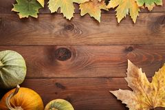 Autumn leafs with pumpkins royalty free stock image