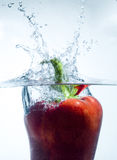 Red bell pepper  splash. A beautiful background with a red bell pepper hitting water and making a splash Royalty Free Stock Photo