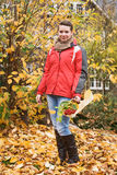 Autumn Leaves. Teenage girl holding basket of autumn leaves and berries Royalty Free Stock Images