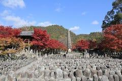 Autumn Leaves Of Adashino Nenbutsu-ji of Buddha statue Royalty Free Stock Photo