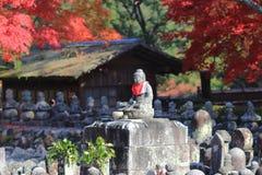 Autumn Leaves Of Adashino Nenbutsu-ji of Buddha statue Royalty Free Stock Photography