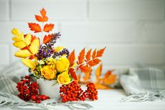 Autumn Leaves And Flowers On A Wooden Table. Autumn Background With Copy Space. Autumn Still Life. Stock Photo