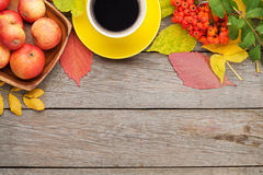 Autumn leaves, apple fruits and coffee cup Royalty Free Stock Photos