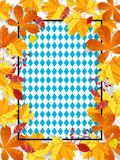 Autumn leaves on a background pattern of blue diamonds. Traditional fall Oktoberfest background. National German autumn. Autumn leaves frame on background Stock Image
