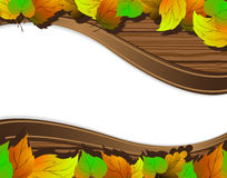 Autumn leaves background. Autumn leaves on the wooden background with place for text Stock Photos