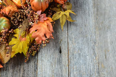 Autumn leaves and berry over wooden background Royalty Free Stock Photography