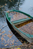 Autumn leaves and boat Stock Image