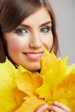 Autumn leaves, close up woman face. Yellow autumn leaves, close up woman face Royalty Free Stock Photo