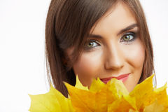 Autumn leaves, close up woman face. Yellow autumn leaves, close up woman face Stock Images