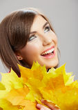 Autumn leaves, close up woman face. Yellow autumn leaves, close up woman face Royalty Free Stock Image