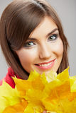 Autumn leaves, close up woman face. Yellow autumn leaves, close up woman face Stock Photo