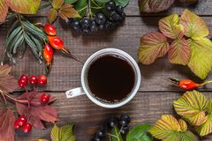 Image with autumn leaves. Autumn leaves and coffee on a wooden background Stock Photos