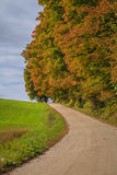 Autumn leaves and a country road. A road in Vermont with colorful foliage Stock Photography