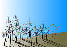 Autumn Leaves Fall on Blue Day. Autumn leaves fall and are stirred by the wind on a clear blue day Stock Image