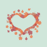 Autumn leaves frame with heart-shaped Stock Images