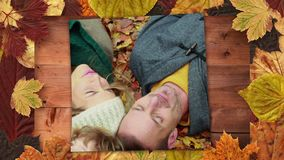 Autumn leaves frame and screen showing family lying on autumn forest. Digitally generated video of autumn leaves frame and screen showing family lying on autumn stock video footage