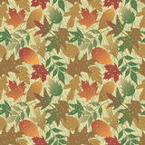 Autumn Leaves Grunge Pattern. A 12 square seamless, repeating pattern of stylized Autumn leaves with grungy textures Royalty Free Stock Photos