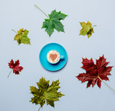 Autumn leaves and heart shape cappuccino Royalty Free Stock Photography