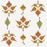 Autumn leaves, imitation of cross-stitch royalty free stock photo