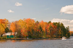 Autumn leaves and lake cabin stock photography